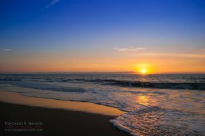 The Sun Rising Over The Sea by LenseMan