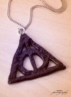 The symbol of the Deathly Hallows by Kattvalk