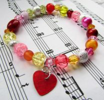 Pink red orange yellow and silver stretch bracelet by TerraNovaJewels