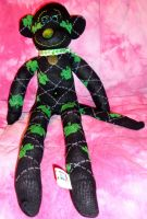 monkey of sparkly green clovers by wiccanwitchiepoo