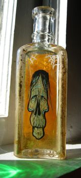 Shrunken Head by grimcinder