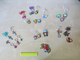 Necklaces and keychains by msSUPERGIRLX3