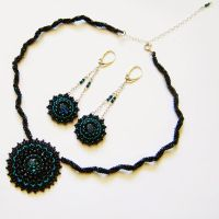 Baskas embroidered webbing set with dichroic glass by Sol89