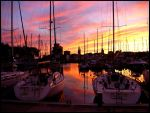 Sunset over the harbor by Claire-de-lune61