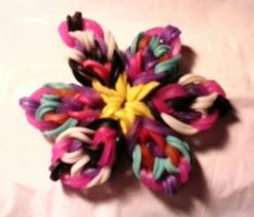 loom band flower with crochet hook by crochetamommy