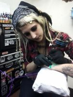 me tattooing by SquidPuke