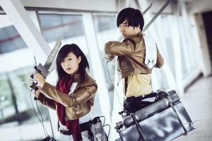 Watch out titans!- Mikasa Ackerman and Eren Yeager by dolcedon