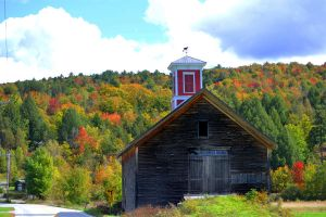 Red Barn in fall color by jerrinator