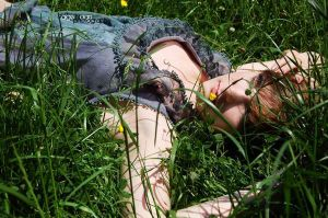 laying beneath the grass by dreamwaster