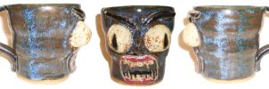 Angry Blue Face Cup by aberrantceramics