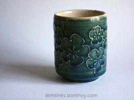 Blossoms in green tea cup by skimlines