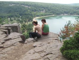 Sitting on the edge of Devils Lake by DarkendDrummer