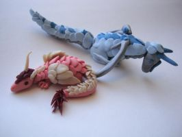 Blue and pink mini dragons by Apolline