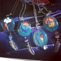 Rainbow pendants by DragonAtaxia