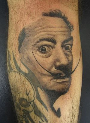 Surrealist Caricature Tattoos - Inked Tributes to Salvador Dali and His