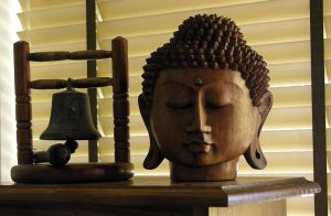 Buddha Head and Bell by Bridie-Stock