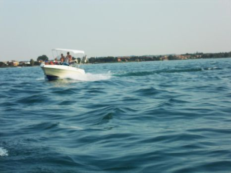 Sirmione and drifting on the water... by saberr-desu