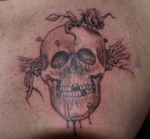 Nailed skull tattoo by GTT-ART