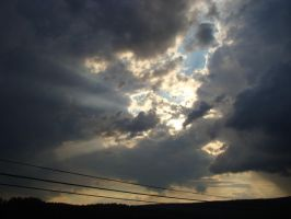 Sunlight Through the Clouds by BlackWingedWolfie