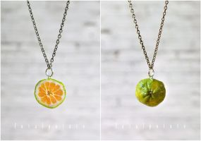 ugli fruit necklace by FatalPotato