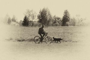 The bicycle man and his small buddy by MrFotkerman