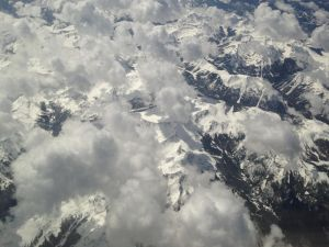 Clouds over snowy mountains aerial by magpienerd