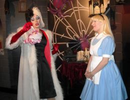 Cruella amused by Cheshire Cat by ChristineFrollophile
