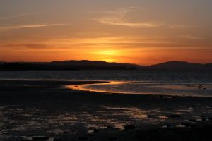 The sun setting on the bay by Doogle510