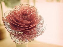Rose made of old leaves by Tristtesse