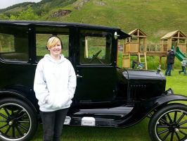 Me next to an old 1920s/1930s car by Feathers-Wings