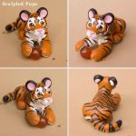 Orange tiger sculpture with fire crystal by SculptedPups
