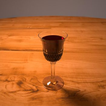 Glass of wine by hellspawned