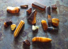Tumbled pieces of Tigers Eye by SkyfireDragon