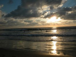 Surfers at Sunset in San Diego by Christianphotos