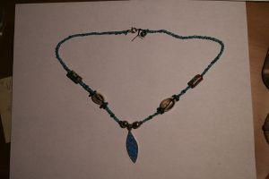 Surfboard necklace by H20dog