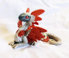Orange Feathered Dragon by ByToothAndClaw