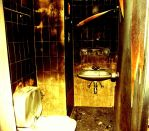 Burned toilet by Nakis
