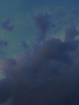 clouds before nighttime or a storm by TanithLipsky