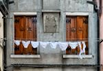 lady behind the closed shutters by Igor-Demidov
