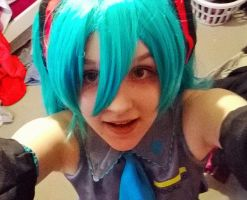 ignore the messy room and look at Miku by maiden-madi
