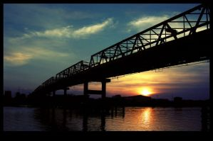 Sunset Over Kapuas Bridge by freaksnerds