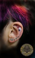 Little Stars color in the ear by 2Face-Tattoo