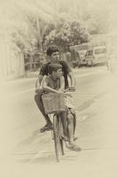 2 boys on a bike by jennystokes