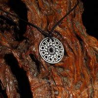 Sun Wheel Necklace - Norse Black Sun by PeSymbolic