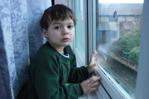 Child at a window on a winter day by BekkiDavies
