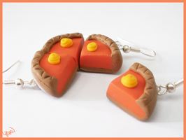 Pieces of cake earrings by CookingMaru