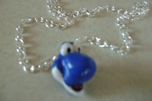 Blue Yoshi necklace front view by Princess-of-Sorrows
