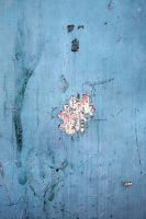 Flaking color on a blue door by mercurycode