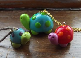 Tortoise pendants by MeticulousBlue