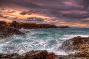 Sea wash on a rocky bay by Kounelli1